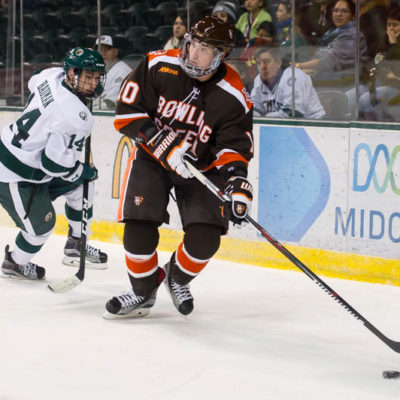 Bowling Green's Kevin Dufour (right) looks to make a play against Bemidji's Kyle Bauman last weekend (Photo by Todd Pavlack/BGSUHockey.com).